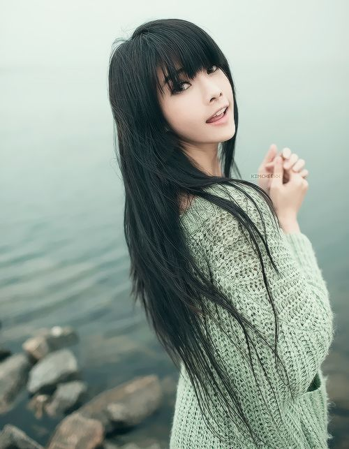 Long layered hair with blunt bangs. on The Fashion Time