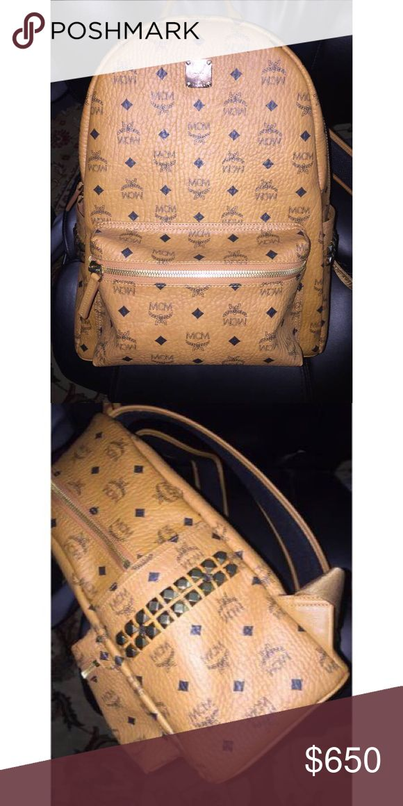 """mcm backpack Medium Stark Side Stud Backpack. ORG price: 790.00  The label's signature logo pattern and side studs lend this luxe MCM backpack a powerful, graphic quality. Top handle, adjustable backpack straps Double zip closure; lined Two interior slip pockets, interior laptop compartment, two exterior slip pockets, exterior zip pocket, interior fits cellphone, tablet and laptop 12.5""""L x 5.75""""W x 15.75""""H; 2.5"""" handle drop Coated canvas/ leather; lining: polyurethane MCM Bags Backpacks"""