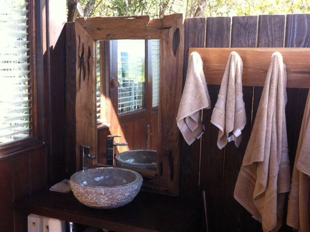 Sink area inside bamboo outside bathroom