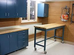 Blue Garage Cabinet Ideas With Wooden Wall And Rolling Table ~ http://lanewstalk.com/the-garage-cabinet-design-for-you-garage-storage/