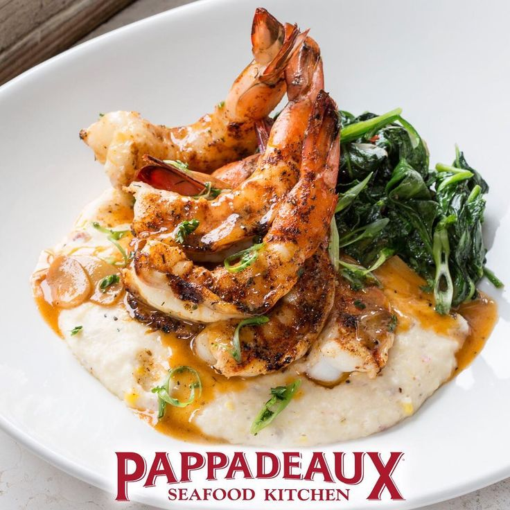 Shrimp and Grits from Pappadeaux Seafood Kitchen - they have locations throughout Texas - the dish has grilled shrimp, sautéed spinach, creamy cheese grits with andouille and sweet corn in a spicy Creole butter