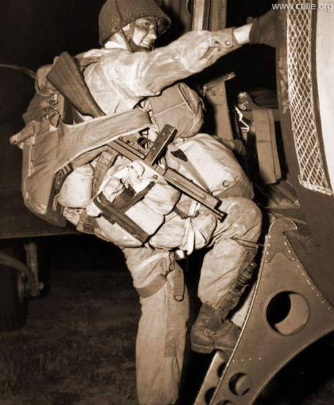 American paratrooper board a C-47 on June 6, 1944 with jump gear for Normandy Invasion
