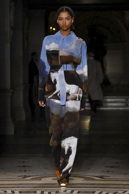 She lives in a house, a very big house in the country - quilted jackets and headscarves, shapely tailoring for a great outdoors jaunt: this was the mood Stella McCartney had in mind this season. [C...