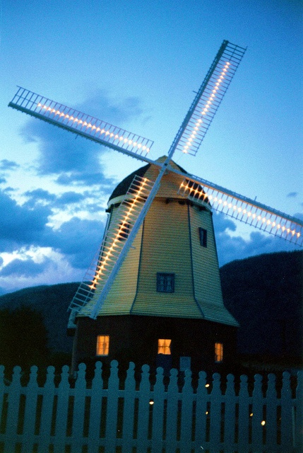 Neon windmill lit up at night in Osoyoos, BC