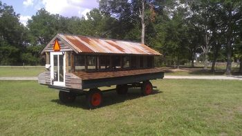 Chicken Tractor from Corn Wagon! We could have a few of these that we can move around with the truck - not everyday but maybe weekly between at minimum 4 spots