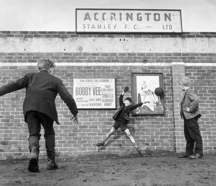 Accrington Stanley. No more football inside the ground so three youngsters play…
