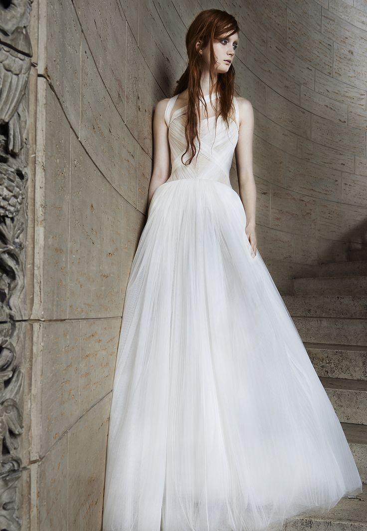 Look 13. Ivory and nude A-line gown with sweetheart neckline accented by hand draped tulle bodice and straps.