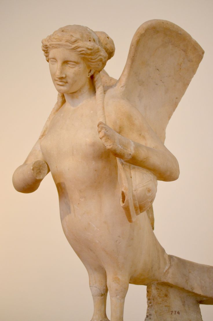 The Siren is lamenting the dead man with her wings raised, playing a lyre made of tortoise shell. The right hand with which she would have been holding the plectrum is missing. Found at Kerameikos, Athens (370 B.C)