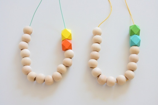 Natural Wood Beads paired with Hexagon Necklace. $12,00
