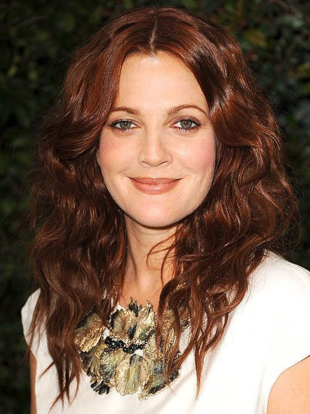 The many hair colors of Drew Barrymore! We love this rich, copper toned mahogany on her - it's the perfect fit. XOXO The eSalon.com Team