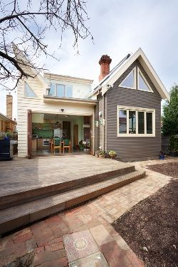 Blend of cute cottage style with modern open style - love this. love the cladding and colours also