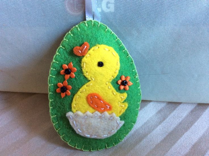 Green egg with duckling and orange flowers
