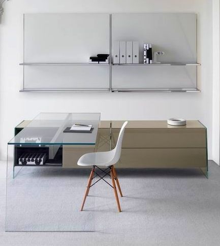 We can use this idea for the reception area...not a clear glass desk but the return can be cabinets?