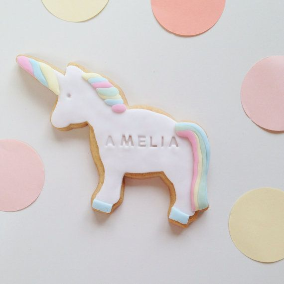 Unicorn gift, for a Unicorn party. Unicorn biscuit in pastel colours, personalised with a name. Includes free shipping to a UK mainland address. Available from Nila Holden on Etsy