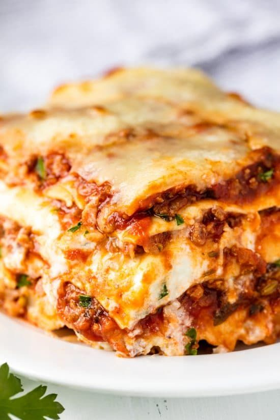 The Most Amazing Lasagna Recipe is the best recipe for homemade Italian-style lasagna. The balance between cheese, noodles, and sauce is perfection!