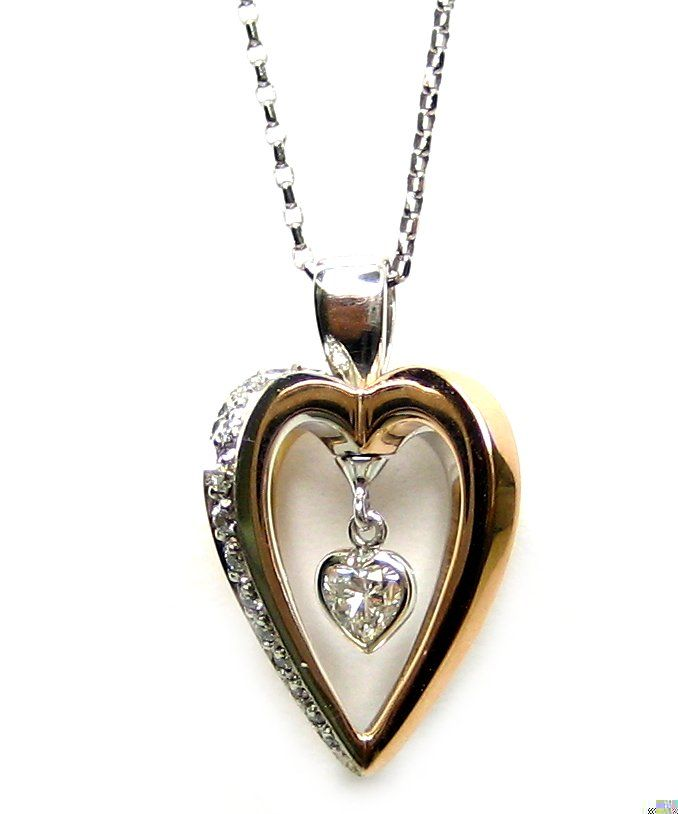 "Our ""Love in Motion"" pendant featuring #gold, #diamonds in interlocking #heart shapes"