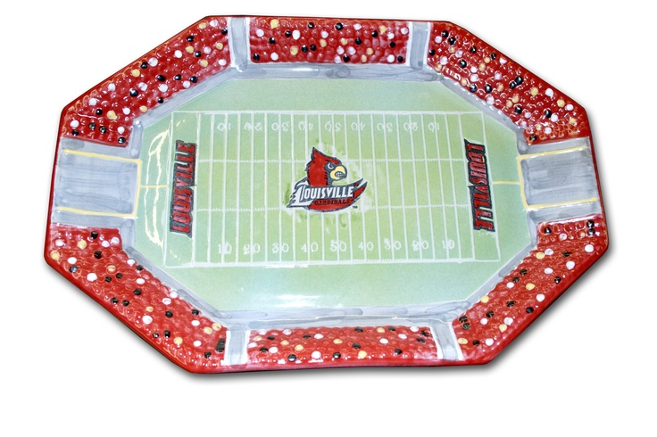 Enjoy serving all your favorites on this handmade, hand-painted octagonal platter, replicating the U of L football stadium. Microwave and dishwasher safe, the field is bluegrass green with a U of L Cardinal in the center. And there's no mistaking all of those Cardinal fans in the stands – just like on game day. $125.00