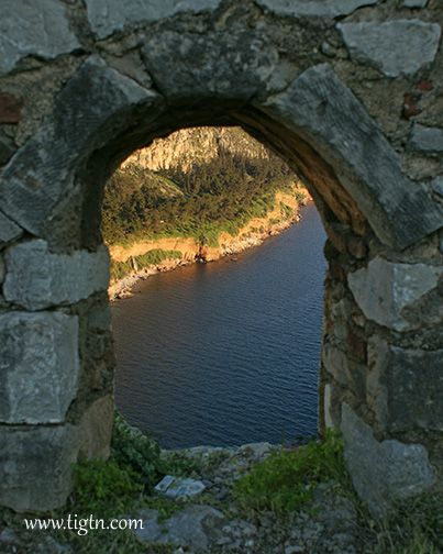 View of the coastline in #Nafplio through an embrasure in the walls of #Akronafplia Castle in the #Peloponnese - #Greece