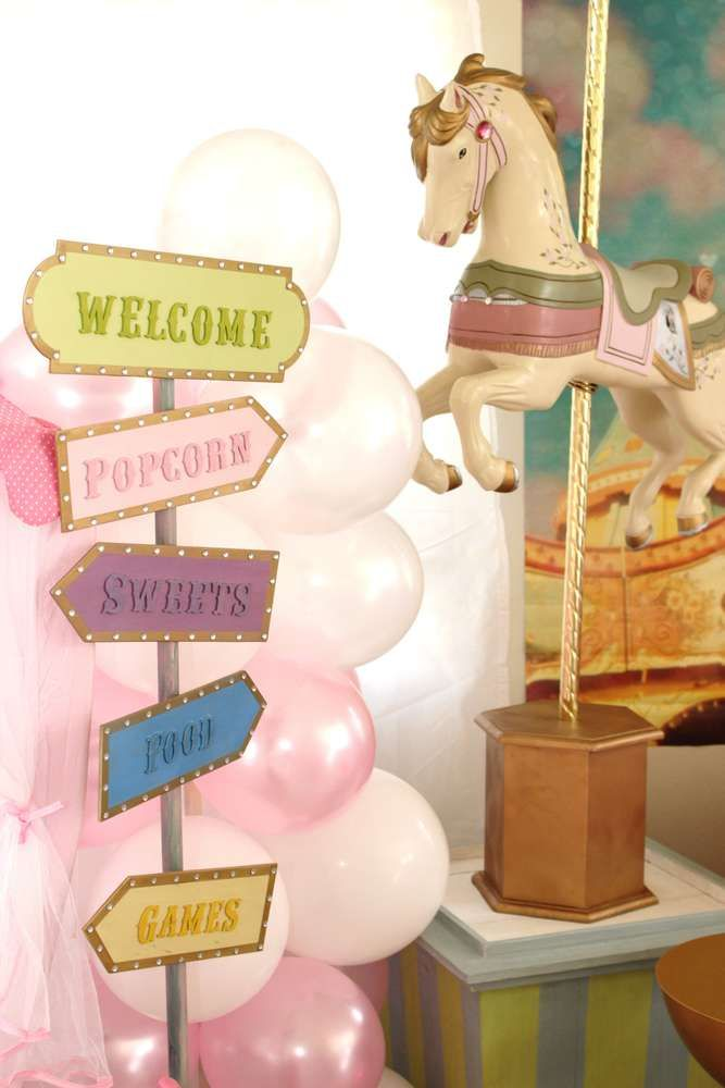 Decorations at a carousel baby shower party! See more party planning ideas at CatchMyParty.com!
