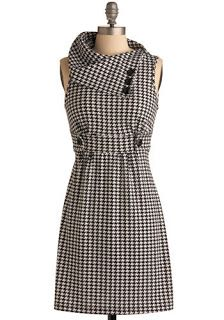 Black and white is such a classic combo. This is a Mad Men style dress with a classic twist. The length is just above the knee, so it's the perfect length for work. And the collar detailing is beautiful.