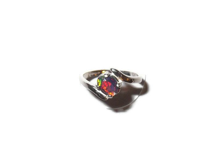 Black Opal Ring - Black Opal Jewelry - Opal Engagement Ring - October Birthstone - Gemstone Ring - Black Opal Solitaire - Fire Opal by BeBeautifulDesigns on Etsy https://www.etsy.com/ca/listing/484553079/black-opal-ring-black-opal-jewelry-opal