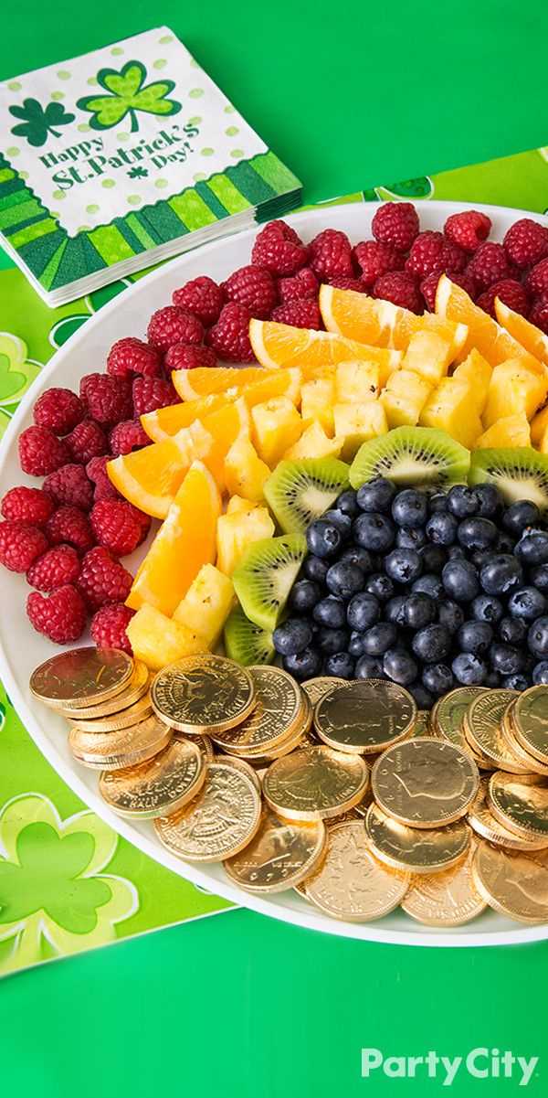 Who says St. Patrick's Day has to be all shades of green? Add a healthy splash of color to your snack table with this how-to rainbow fruit platter! 1.	First gather and slice fruit. We suggest raspberries, oranges, pineapple, kiwi and blueberries. 2.	Arrange each fruit of choice according to its color in a rainbow pattern: red, orange, yellow, green and blue.  3.	Don't forget the pot of gold at the end of the rainbow! Add some gold candy coins to accent your platter with a chocolate treat.