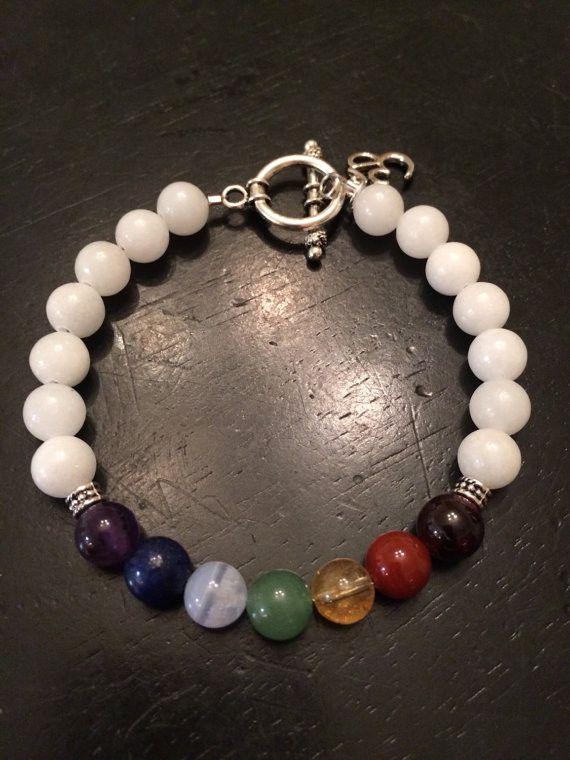 "Healing Crystal Bracelet - Chakra Balancing Bracelet - 7 Chakra Bracelet - Ohm Bracelet - Healing Crystal - healing bracelet- reiki jewelry Made with 8mm Gemstones Garnet - ""stone of health"" - Root Ch"