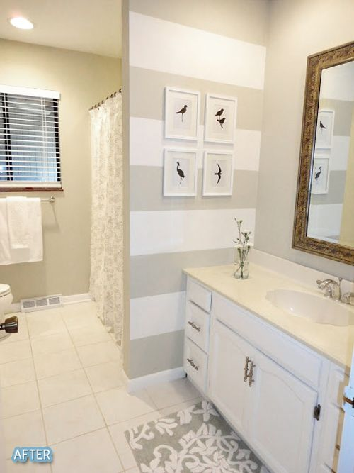 Love the striped wall. What an easy fix for the blah bathroom!: Bathroom Stripes, Idea, Stripes Bathroom, Stripes Wall, Stripes Accent Wall, Grey Stripes, Striped Accent Walls, White Bathroom, Gray Stripes