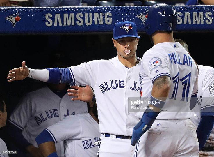 TORONTO, ON - SEPTEMBER, 27 Toronto Blue Jays center fielder Kevin Pillar (11) gets a bubble gum salute from Toronto Blue Jays second baseman Ryan Goins (17) after scoring in the 5th. The Toronto Blue Jays played the Baltimore Orioles in their 1st game of a 3 game series at the Rogers Centre in Toronto. September 27, 2016