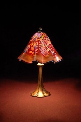 Golden Brown Jack is a beautiful, hand blown piece. Custom Hand Made in our studio in San Diego from 2000 degree molten glass. Tiffany style base is included and is a plated cast metal with an antique