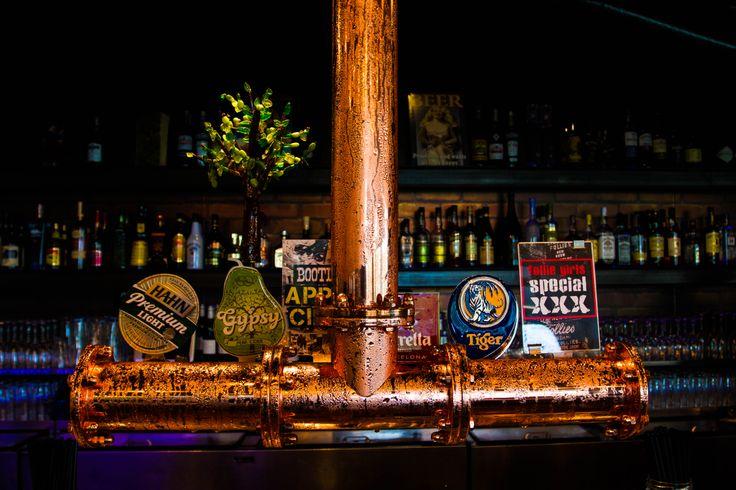 Close up of bar taps in main bar.