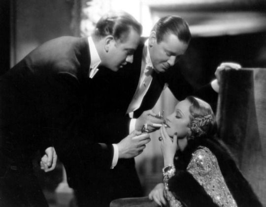 blockmagazine: Marlene Dietrich gets one more light than she needs in Angel (Ernst Lubitsch, 1937), with Melvyn Douglas and Herbert Marshall.