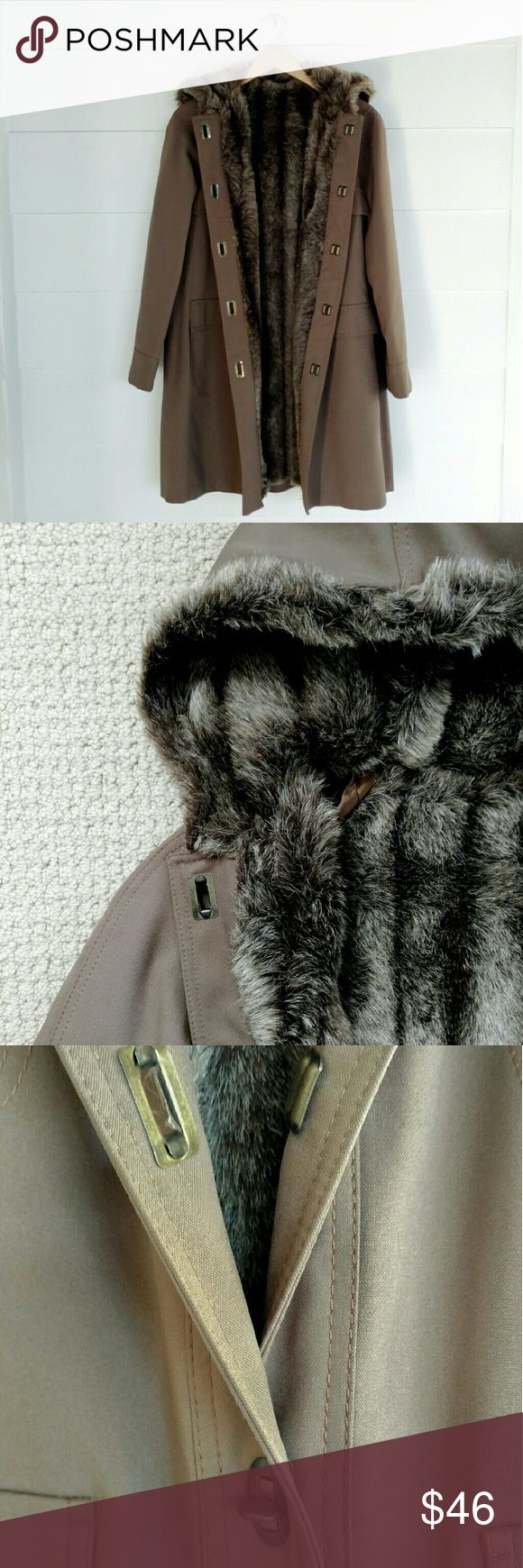 Vintage Faux Fur Coat Vintage coat with faux-fur lining, which I believe is designed for all weather. Made in the USA by the International Ladies Garment Workers Union, one of the first US unions with primarily female membership. Size is listed as 9/10, I think it fits between an 8-10. Can take measurements if you're interested! A few small picks on the outside that I really had to look for, and some picks on the inside lining near the shoulder. A little musty, could use a dry clean but…