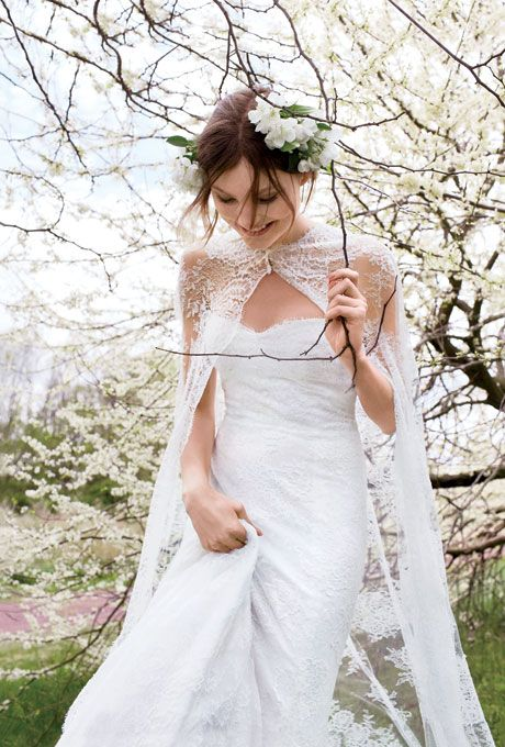 Brides.com: Ethereal Wedding Dresses for an Elegant Outdoor Wedding. Chantilly-lace modified trumpet, $7,700, and cape, $3,900, Monique Lhuillier; Yellow gold and diamond earrings, Zoe Chicco