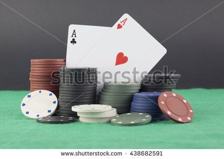 Stack of poker chips and aces