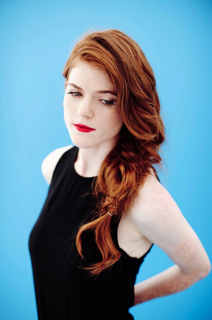 Sporty and sexy portrait of Rose Leslie (Ygritte) with long red hair and striking maekup.