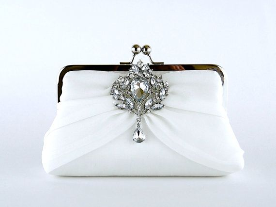 Please always inform me about your event day, Thank you!!! ~~~~~~~~~~~~~~~~~~~~~~~~~~~~~~~~~~~~~~~~~~~~~~~~~~~~~~   This elegant clutch is made from pure silk fabric. It is featuring flowing chiffon silk and a diamond brooch. I use pure dupioni or taffeta silk for the body of the clutch as the silk fabrics have a crisp texture and beautiful sheen. Dupioni silk has an irregular weave with tiny nubs showing while taffeta is machine made and there are no nubs. One of the oldest luxury fabrics…