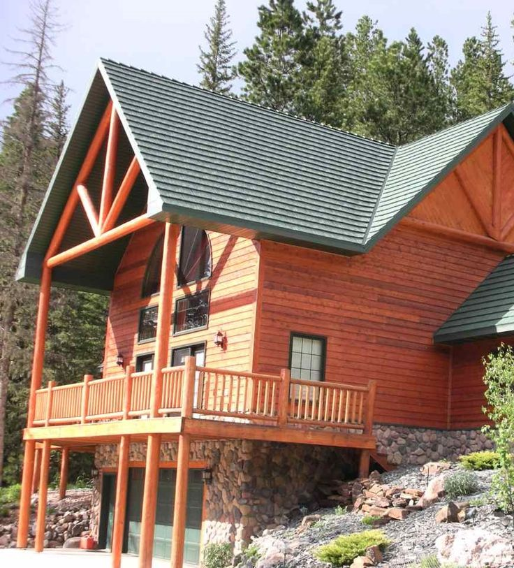 Large Log Cabin Inspired Home With A Green Metal Roof