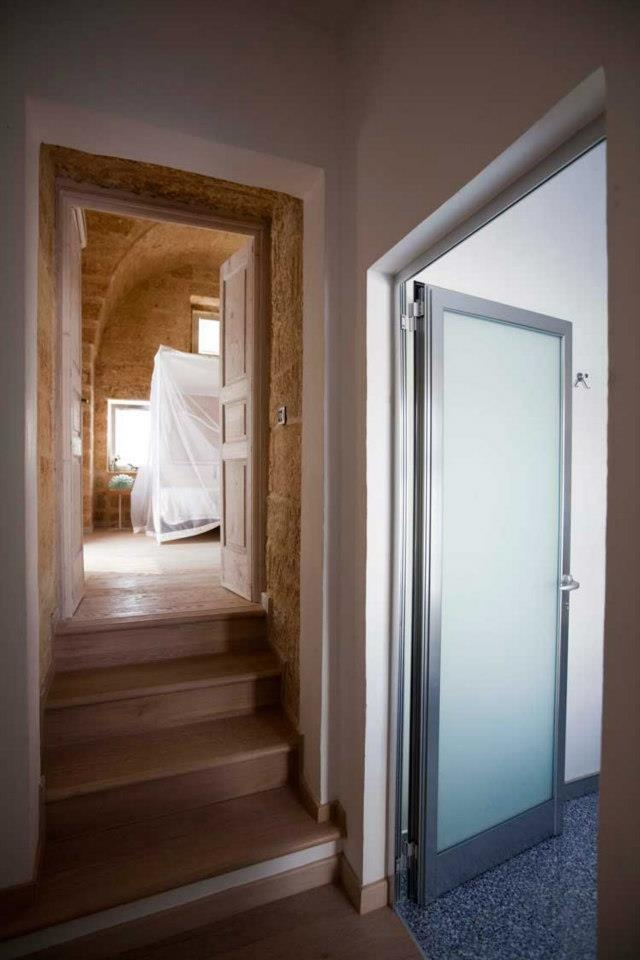 Project: Luca Fiocca Architetto. #Kitchen Project #Arclinea 'Convivium' in stainless steel and teak by Bauhaus Lecce.  Ph. Studio Reportage, Nicola Nardo Marino. #architecture #architect #salento #italy