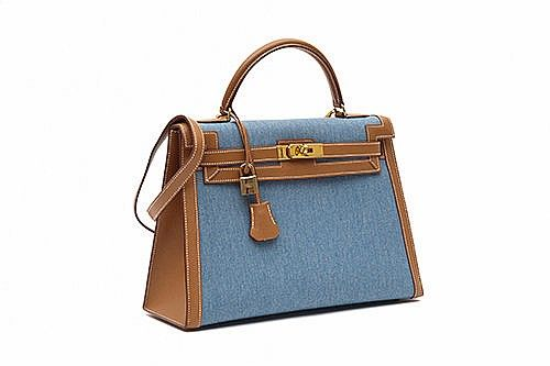 "Handbags we love. The Hermes ""Kelly"" bag, c. 1999. Denim, leather and gold stitching - by Cornette de Saint-Cyr"