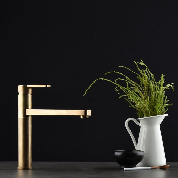 Dark and dramatic: Here our Zeos Sink Mixer takes centre stage in the magnificent organic Antique Brass Light finish. Pair with inky slate or moody granite for the optimum look. #faucetstrommen #zeos