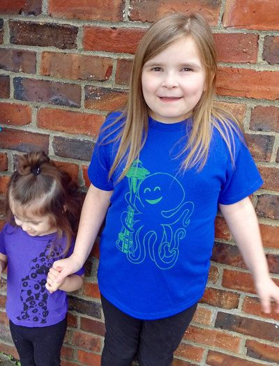 Want a special Seattle gift for kids? Our Space Needle Octopus is cute and fun. With blue and green pride, it perfect for them to wear to Seahawks, Sounders, or Mariners games. Available in toddler, and kids youth sizes. Get one today: http://revivalink.com/collections/1302900-kids-shirts/products/16343196.  Seattle Shirt, Gift for Kids, Seahawks Shirt, Sounders T Shirt, Octopus Shirt, Kids Shirt, Graphic Tee, Boys Tee, Girls Tee, Seattle Gift