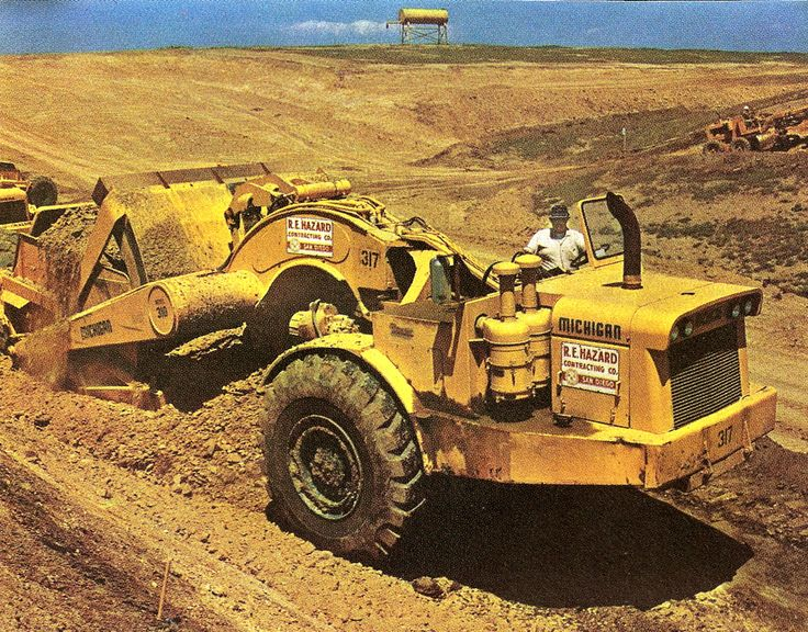 One of R E Hazard's Michigan 310s gets a heaped load of California sandy loam on the San Luis aqueduct project, 1969. Hazard was a big user of Clark/Michigan equipment and made a lot of money with them. The twin air-cleaners are a noteworthy field modification.