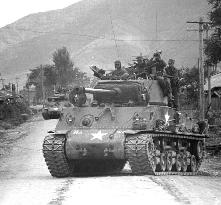 M4A3E8 Sherman of the 89th Tank Battalion advancing north through ...