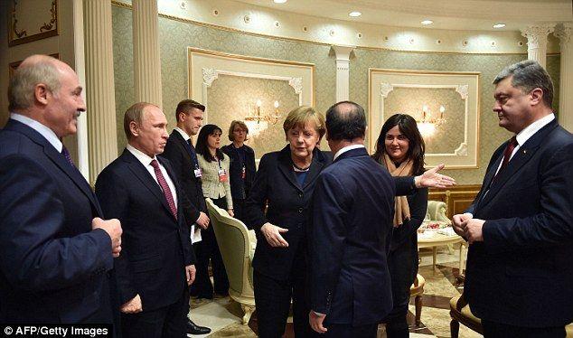 Belarus' President Alexander Lukashenko (left) attempts to lighten the mood while Presiden...