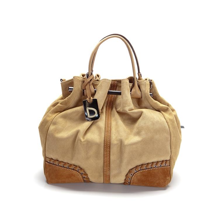 Bolso cofre en beige y marrón. Por 95 euros, gastos de envío incluidos