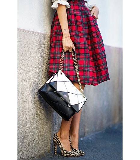 @Who What Wear - Street Style  If you'd like to add some attitude to your look, try pairing two bold prints: plaid and leopard.