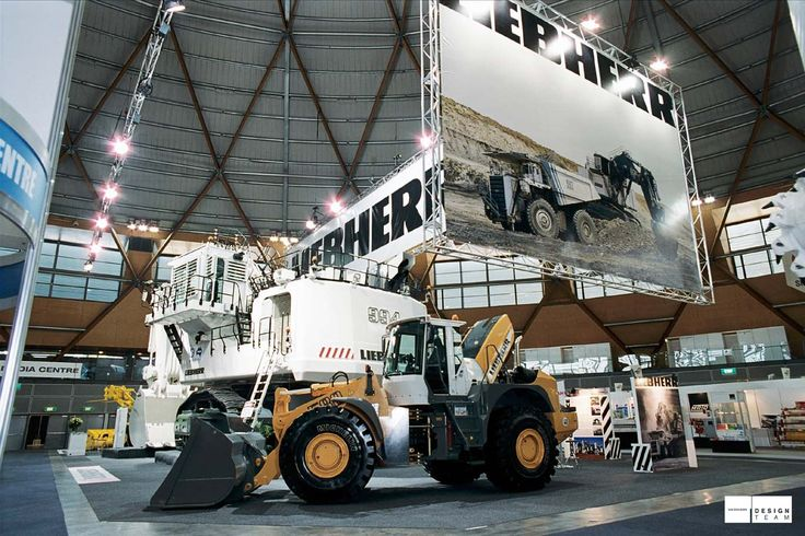 LIEBHERR @ AIMEX Big machinery calls for big branding for Liebherr at AIMEX. Sales staff comfortably present product on the floor and close deals within private meeting rooms