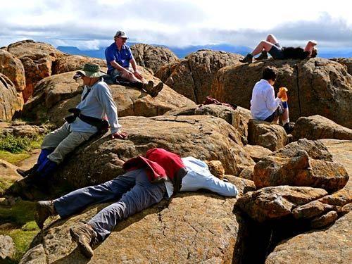 Hikers rest at the summit of Mt. Ossa, Tasmania's highest peak.