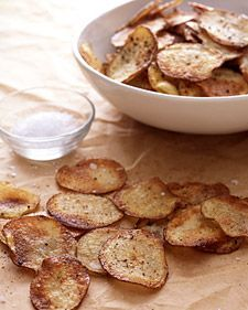 """Baked Potato Chips - Martha Stewart Recipes - Today, Zeke picked potatoes from the garden, and tonight I made this recipe.  The kids weren't as interested for some reason, so Zeke and I each at a pound of homemade potato chips (oops).  One tip, make sure you cut them thin, perhaps thinner than a 1/4"""", so they get nice and crispy."""